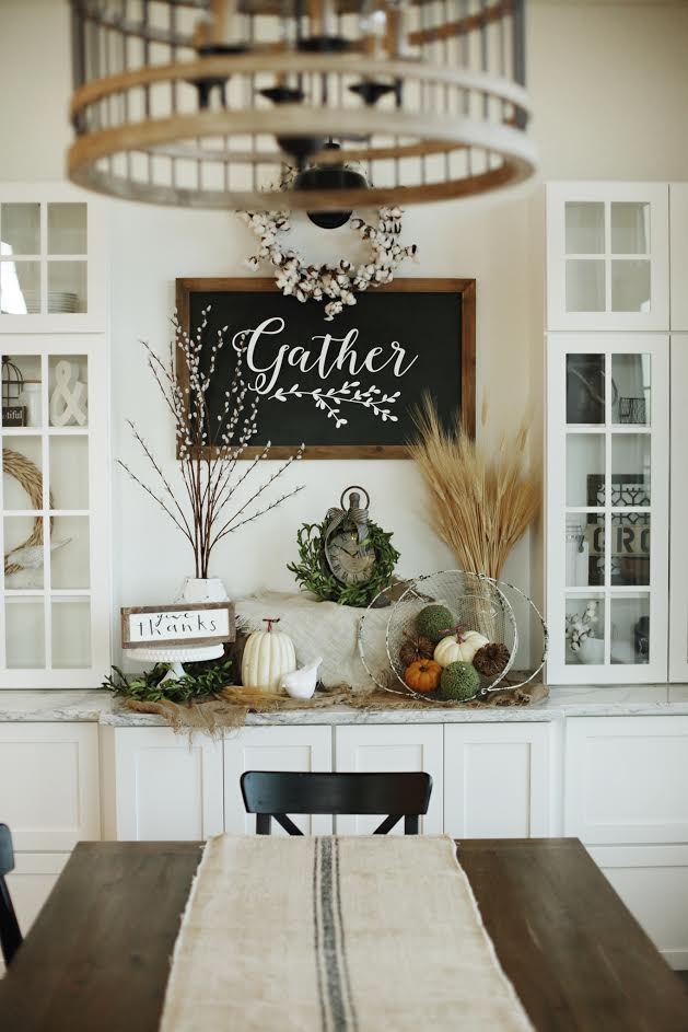 Custom Built Modern Farmhouse Home Tour with Household No 6 | White built in storage display, Gather chalkboard, cottn wreath, chadlier & grain sack runner drapped farm table dining
