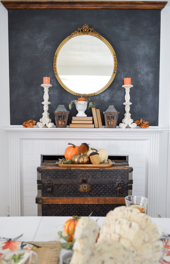 Beginner Friendly Thanksgiving Tablescape. Chalkboard fireplace mantel with vintage gold mirror and trunk