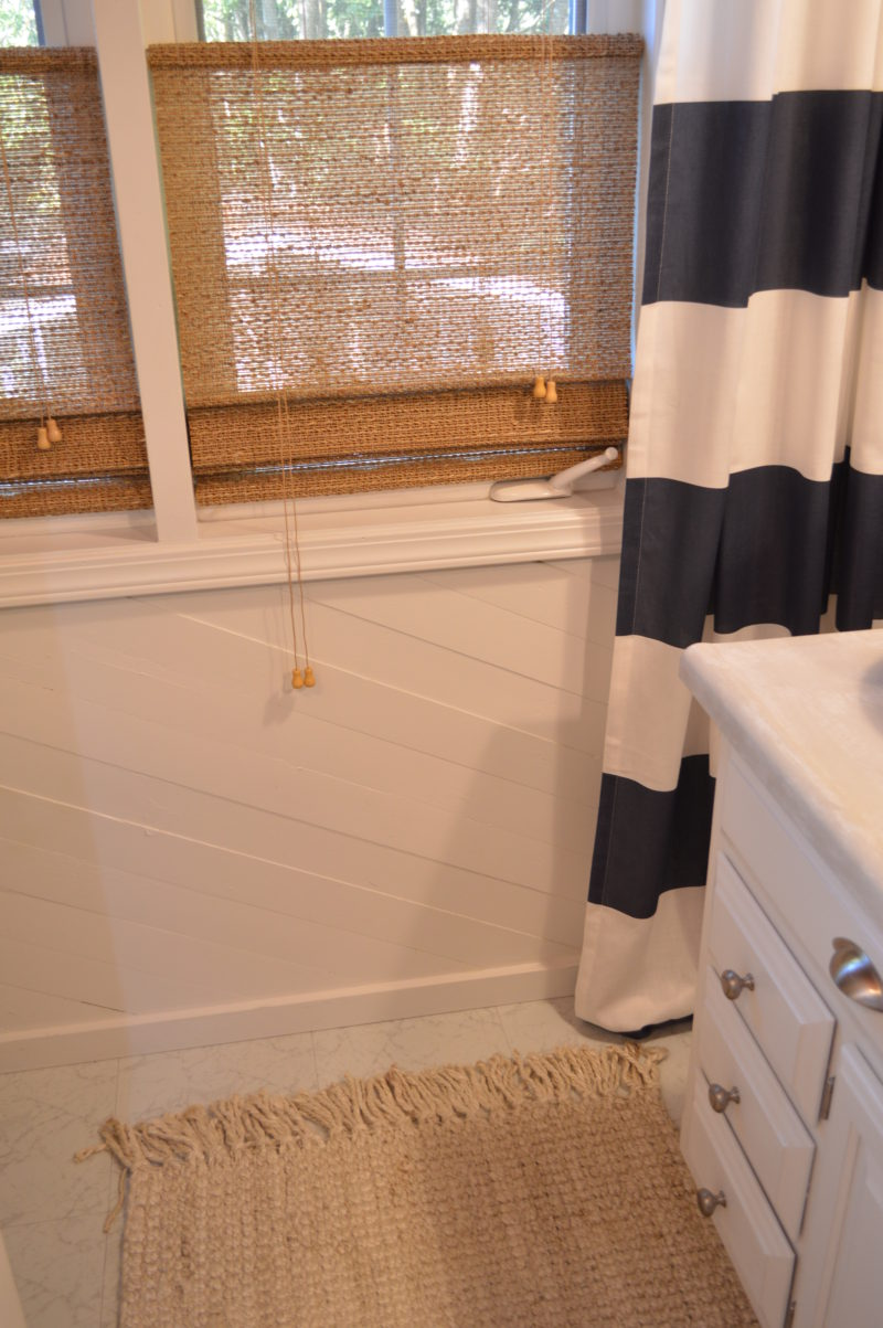 Navy Bathroom Budget Breakdown and Shopping Sources | Woven natural rug and roman shade blinds