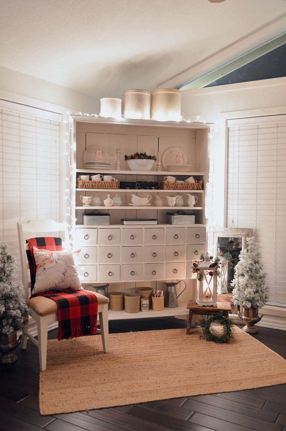 Merry Christmas, twinkle lights- Vintage holiday decorating, apothecary cabinet. Crock collection, plaid accents.