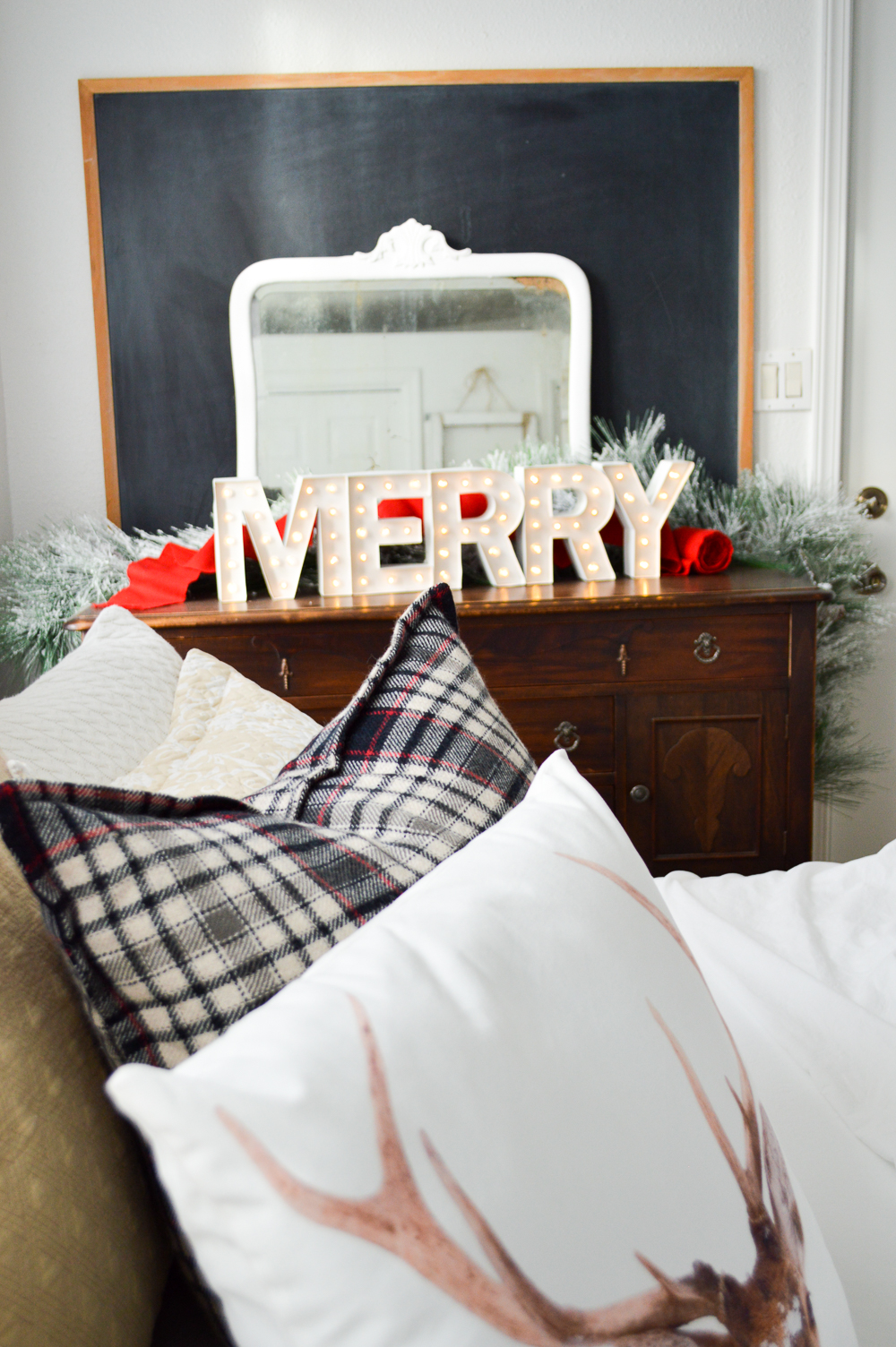 Merry Christmas Guest Bedroom at The Little Cottage foxhollowcottage.com Holiday marque light, layered with vintage mirror and old school chalk board on wood buffet.