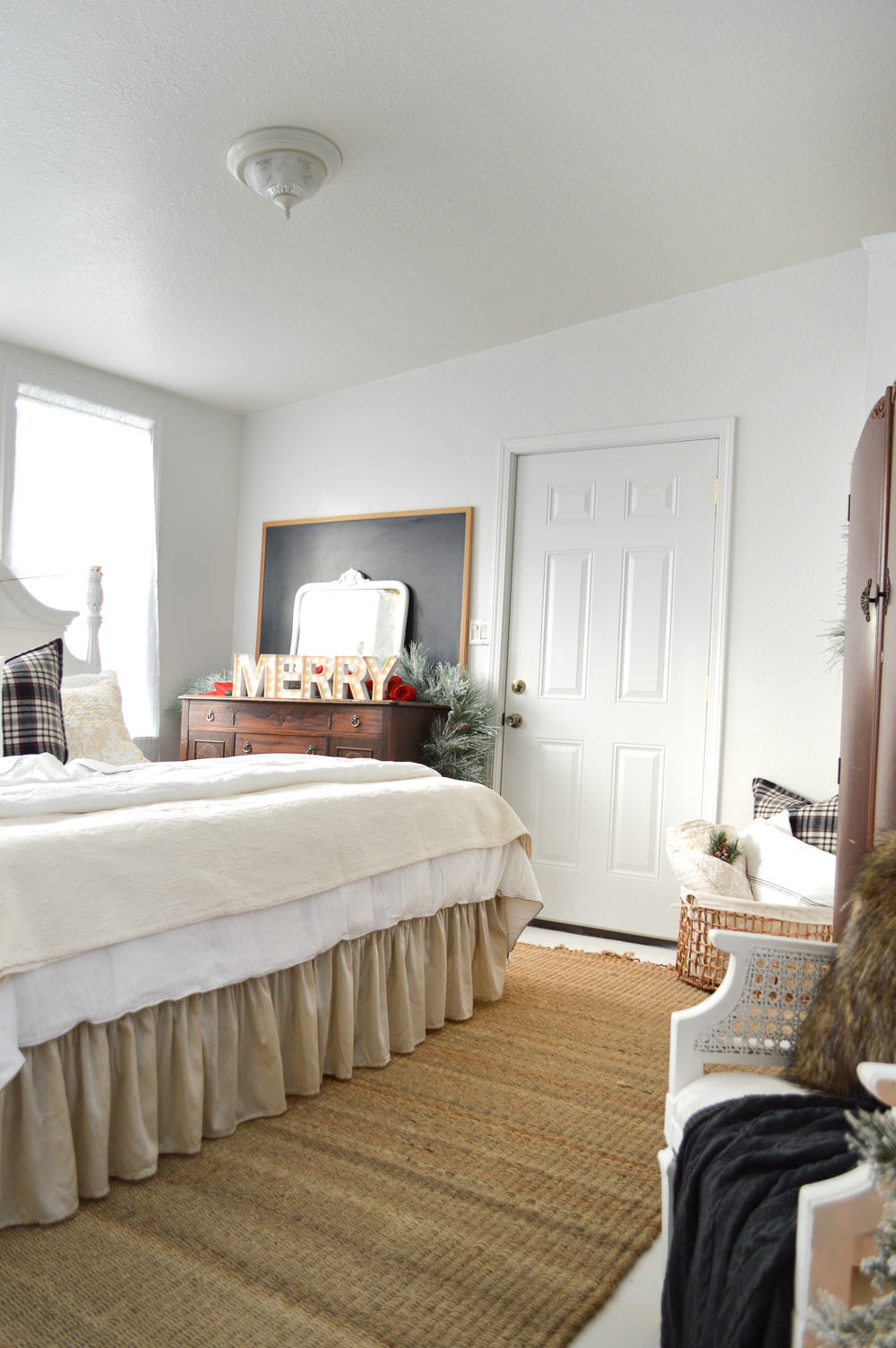 Christmas Guest Cottage Bedroom. Farmhouse style, charcoal grey, plaid and neutral, fur and snowy Fir trees.