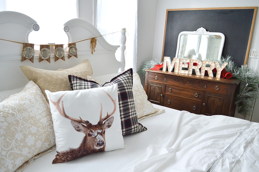 Christmas Guest Cottage Bedroom. Cottage farmhouse style bedding, plaid and neutral, stag pillow, MERRY marquee lights.