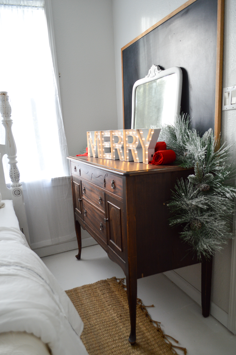 Merry Christmas Guest Bedroom at The Little Cottage foxhollowcottage.com Love the layered chalk board and vintage mirror on this old wood buffet