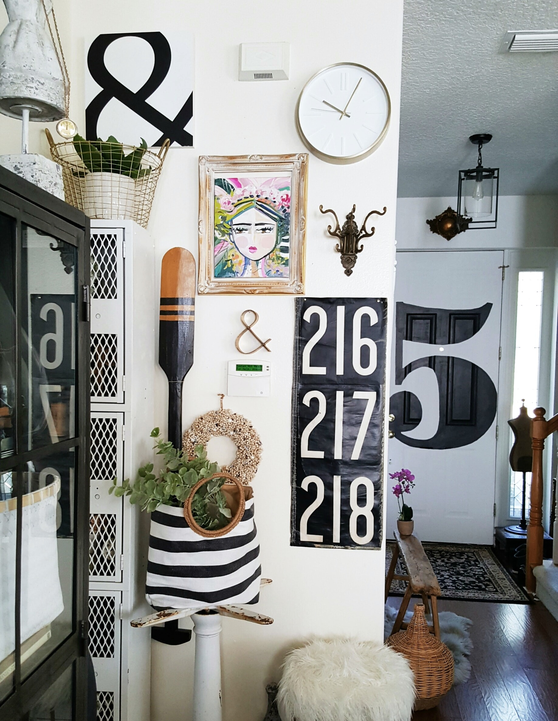 Eclectic Collected Vintage Modern Home Tour - Black and white gallery wall door decor painted typography number