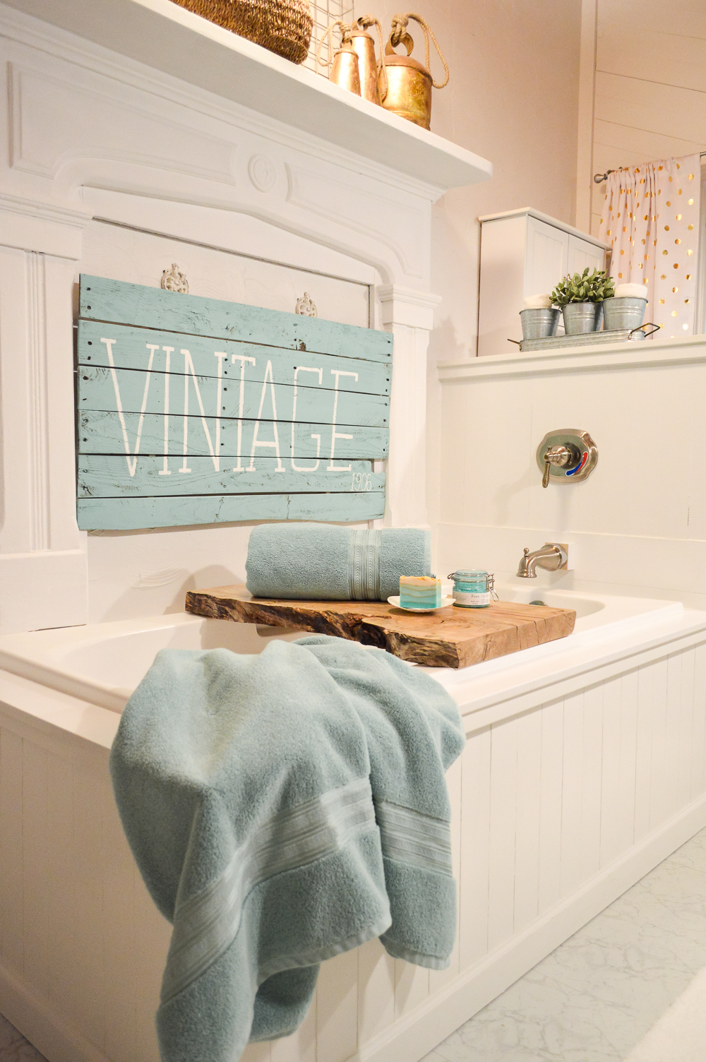 Aqua Summer Bathroom Refresh | Cottage bath, vintage mantel over shiplap wrapped soaker tub.