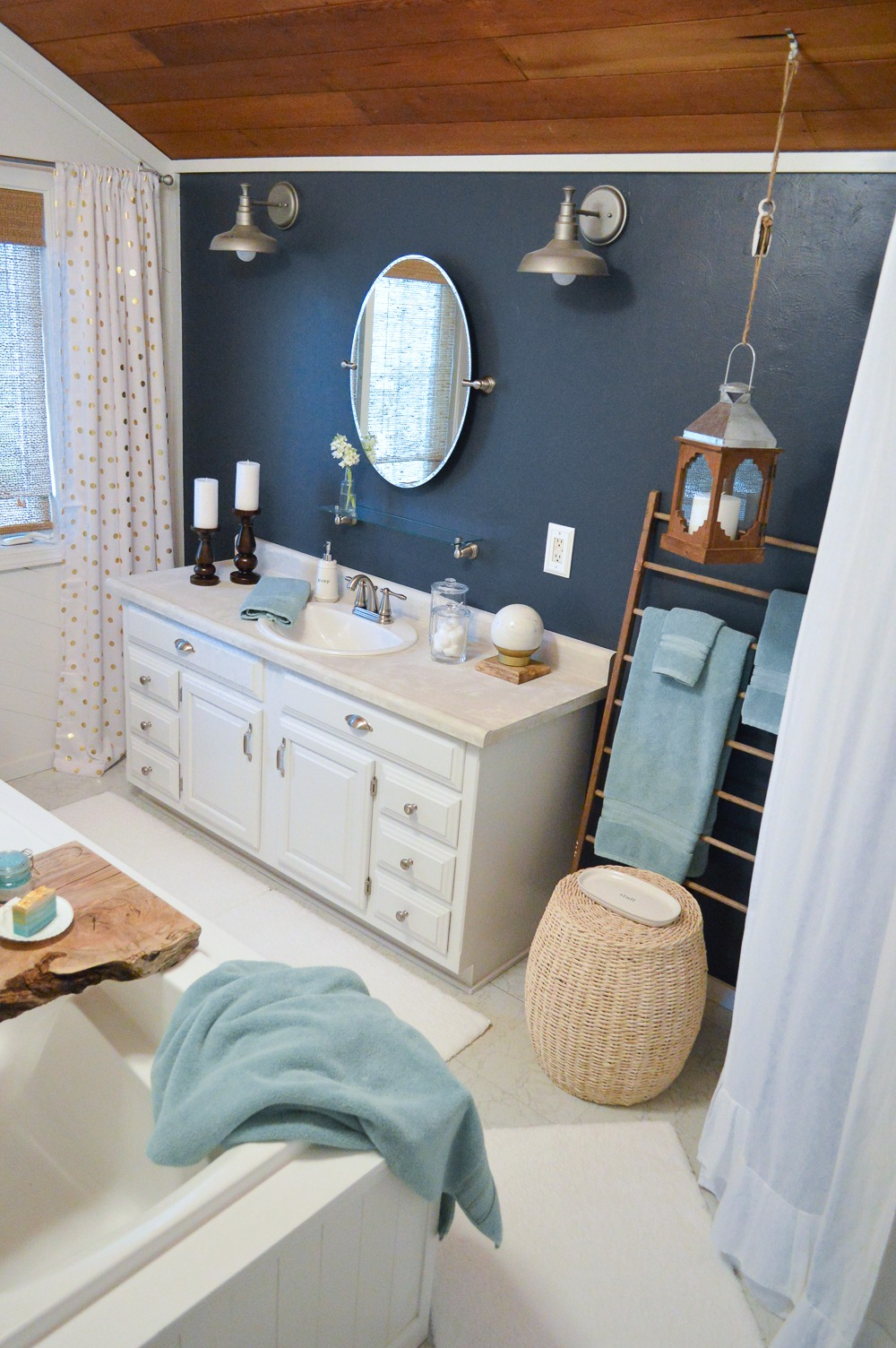 Aqua Summer Bathroom Refresh | Eclectic bath mini makeover; Hale Navy walls, white vanity, galvanized farmhouse lighting.