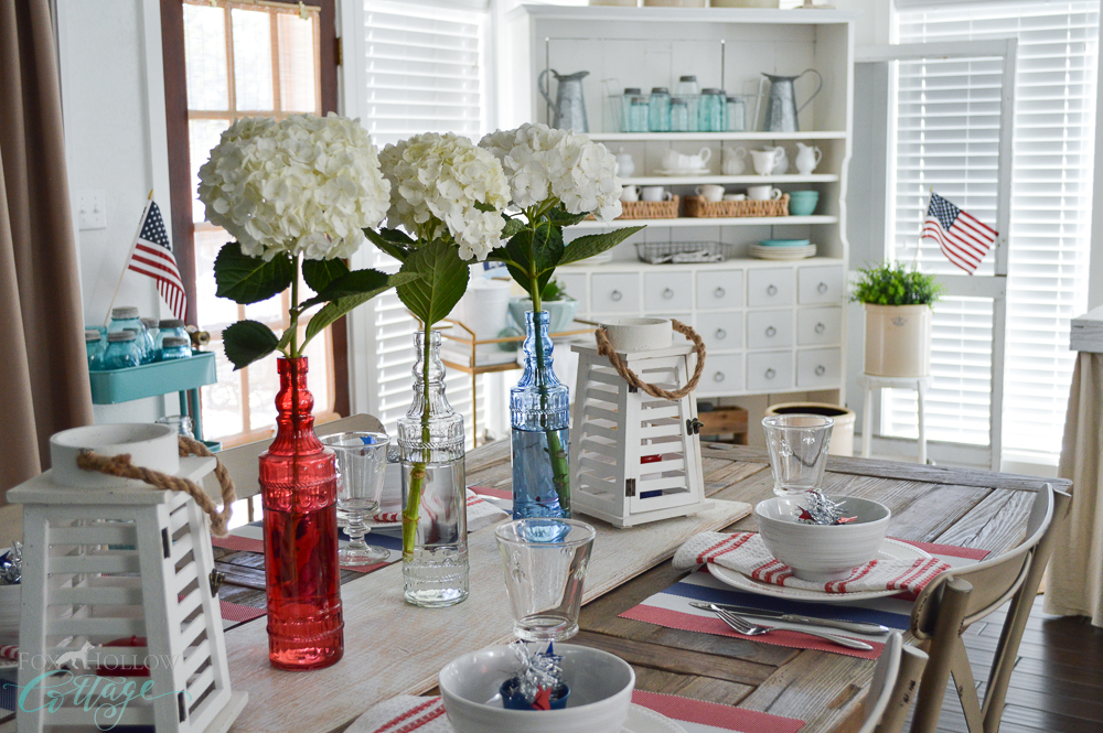 Easy Hydrangea Glass Bottle Centerpiece, Cottage Farmhouse Decorating Ideas - 4th of July at foxhollowcottage.com