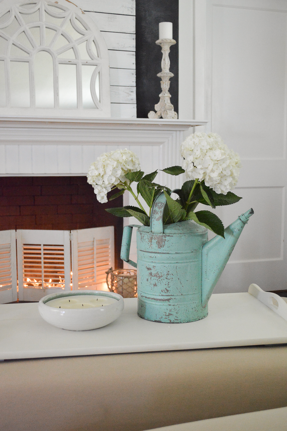 My New Improved Aqua Front Door, Coastal Cottage Home Decorating - www.foxhollowcottage.com - Vintage watering can, Hydrangeas in front of fireplace