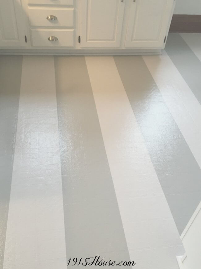 Grey and White Stripe Painted Linoleum Kitchen Floor by 1915 House - Painted Vinyl Linoleum Floor Makeovers and Tips