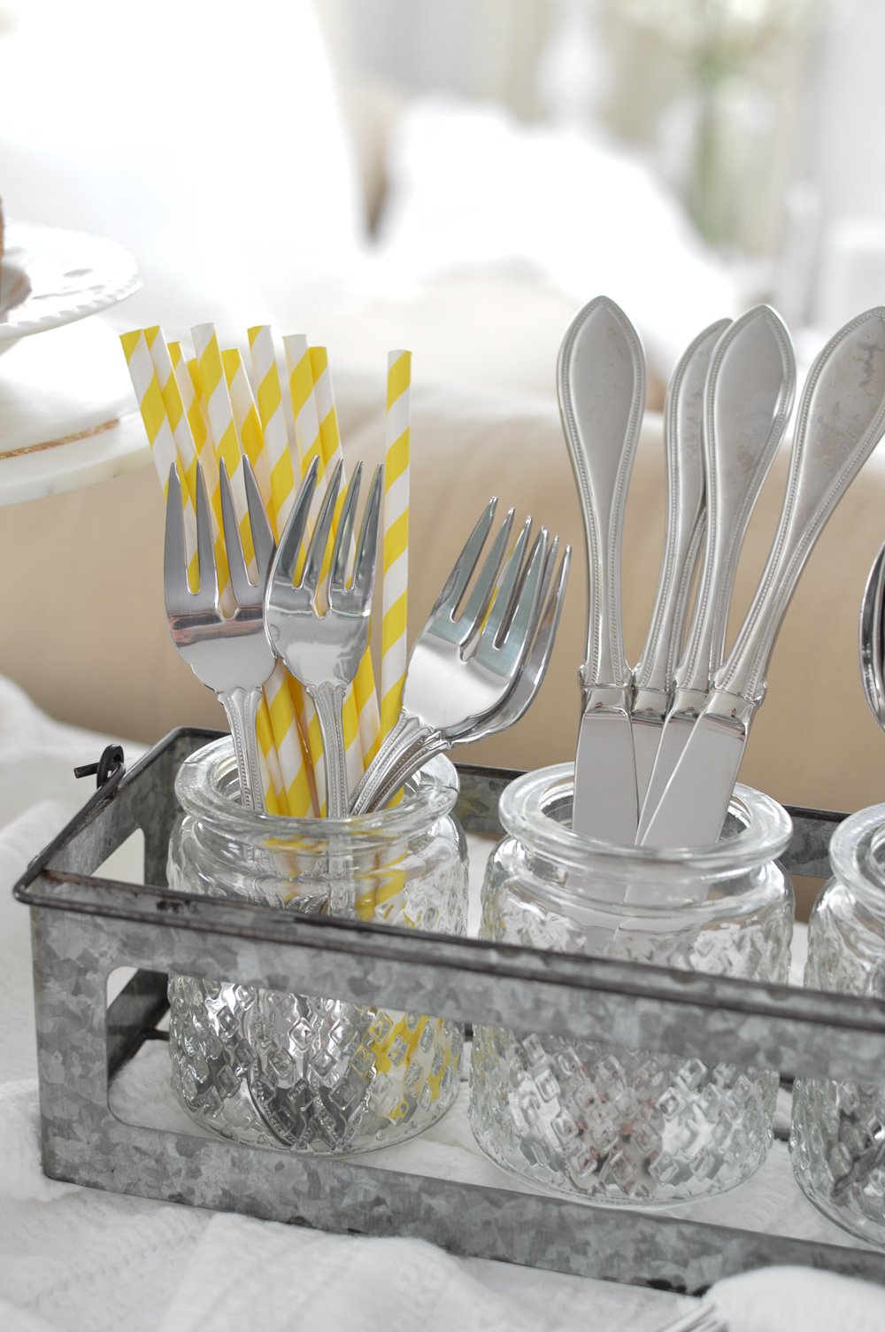 Use a tea light candle caddy to store flatware/silverware & pretty paper straws