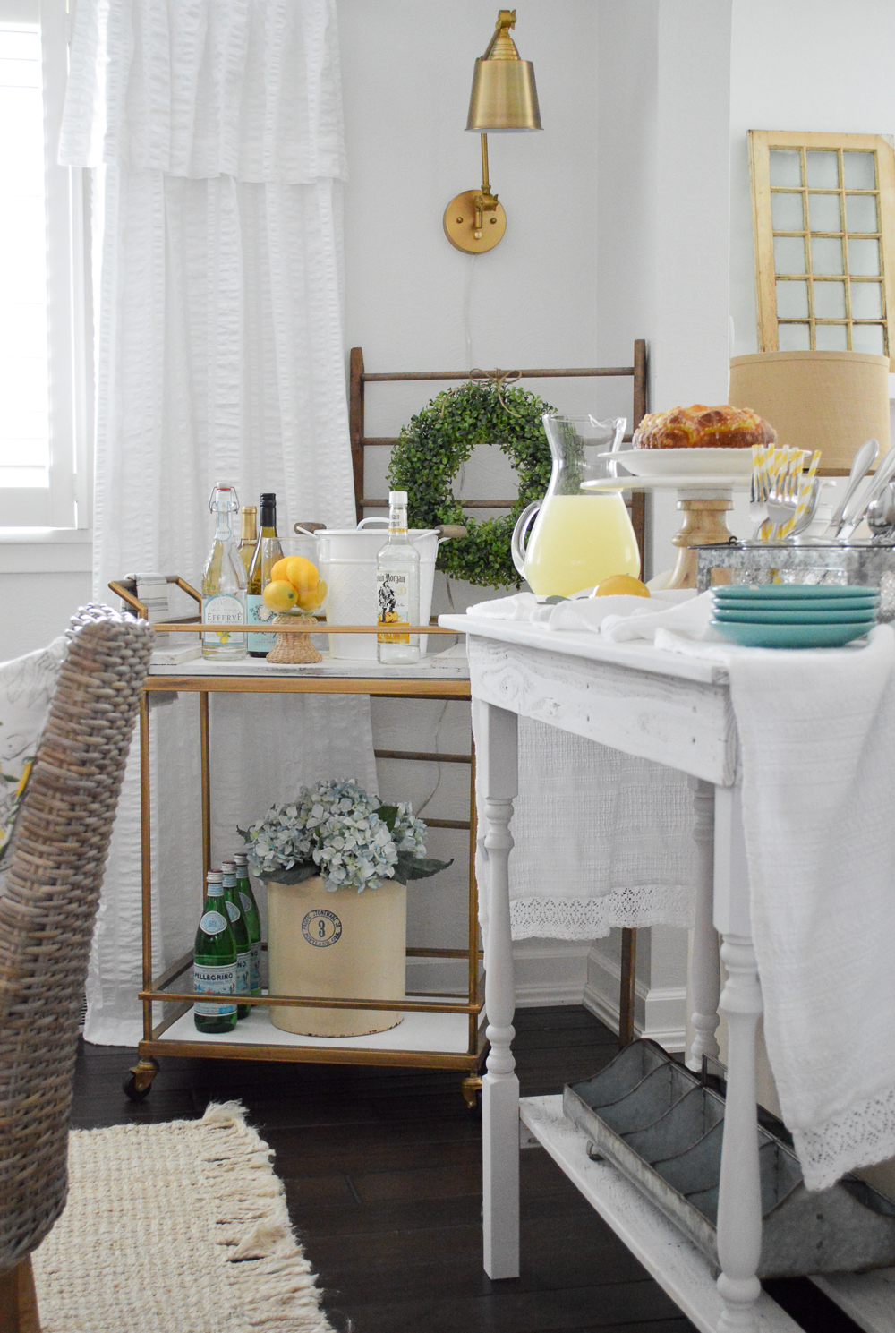 Love the gold bar cart and the brass wall sconce!