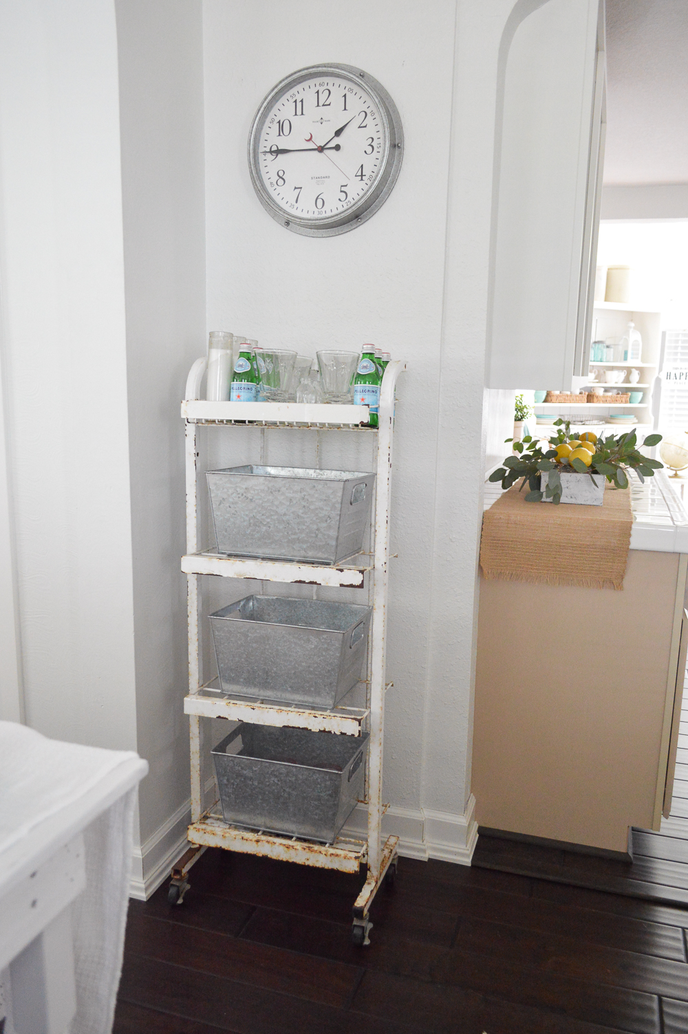 old rusty vintage store display - turned storage with galvanized bins