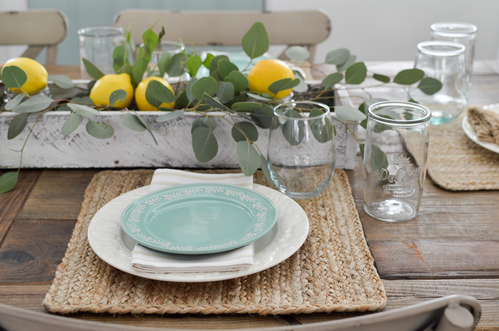 Simple Summer Decorating Ideas and Home Tour - lemon centerpiece and natural elements, woven placemats, white and aqua plates