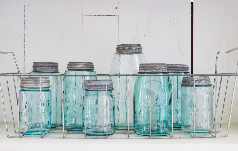 Old galvanized freezer basket with vintage aqua mason jar collection | Simple Summer Decorating Ideas and Home Tour