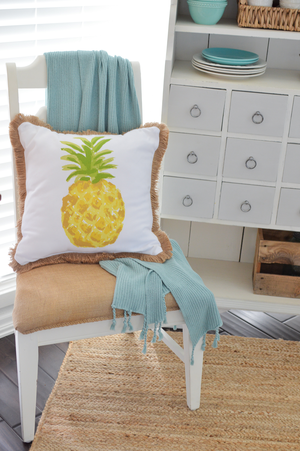 DIY coffee sack painted chair makeover, Pineapple pillow with fringe and aqua throw.
