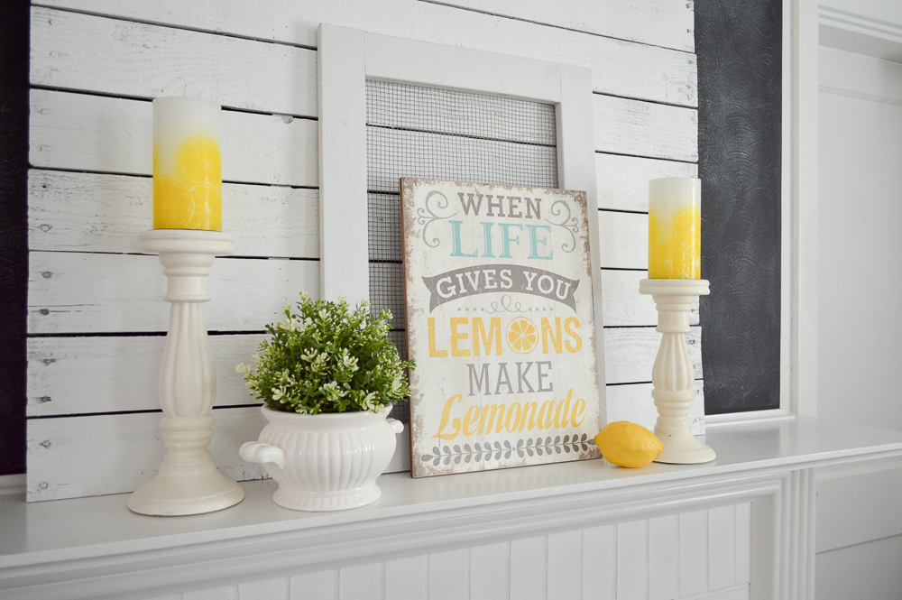When life gives you lemons mantel decor for summer. Love the lemon candles!