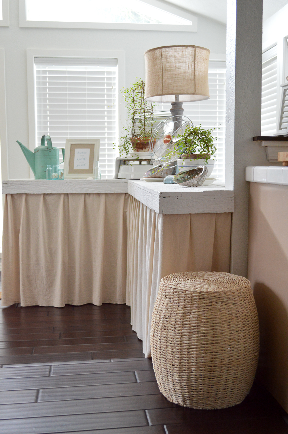 DIY laminate bar makeover with drop cloth hidden storage.