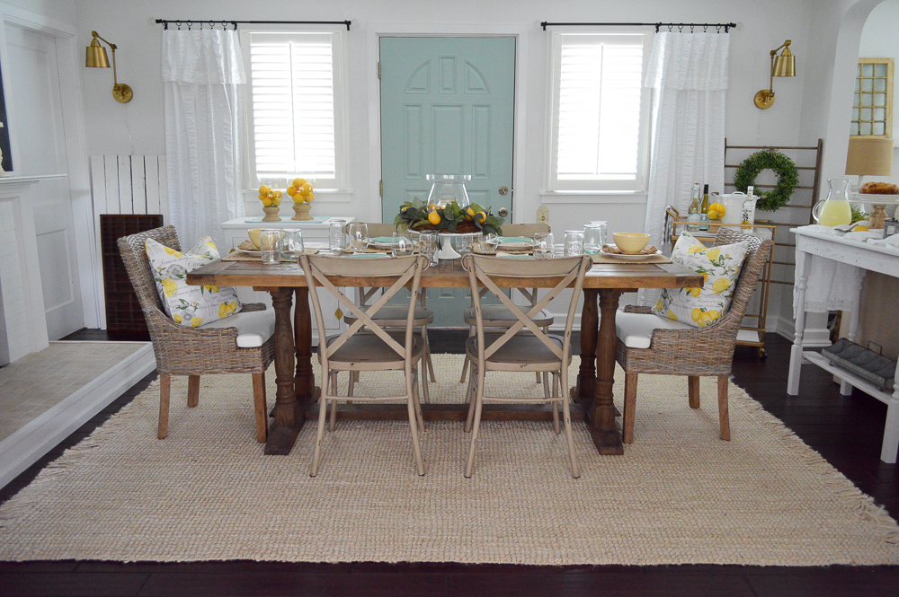 Love the aqua door! Farm table with farmhouse metal chairs mixed with coastal woven dining chairs.