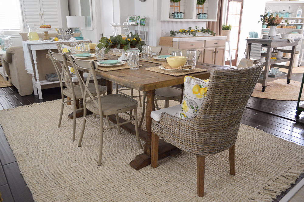 Simple Summer Decorating Ideas and Home Tour - Farm table for 6 with metal and wicker chair mix.