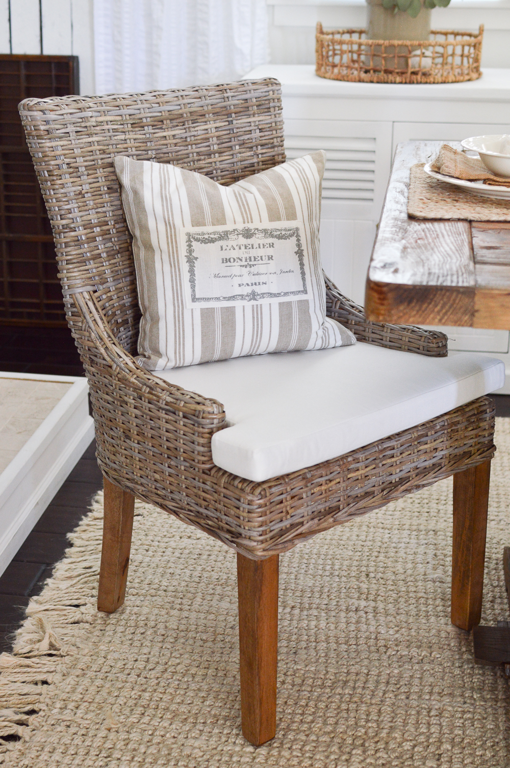 Rattan dining room chair with French grain stripe pillow - Farmhouse dining room Fall farm house decorating ideas