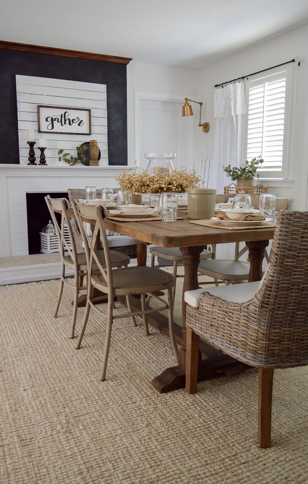 Easy Summer to Fall Dining Room Decorating Ideas - Farmhouse farm table and fireplace with 'gather' sign from Lolly Letters