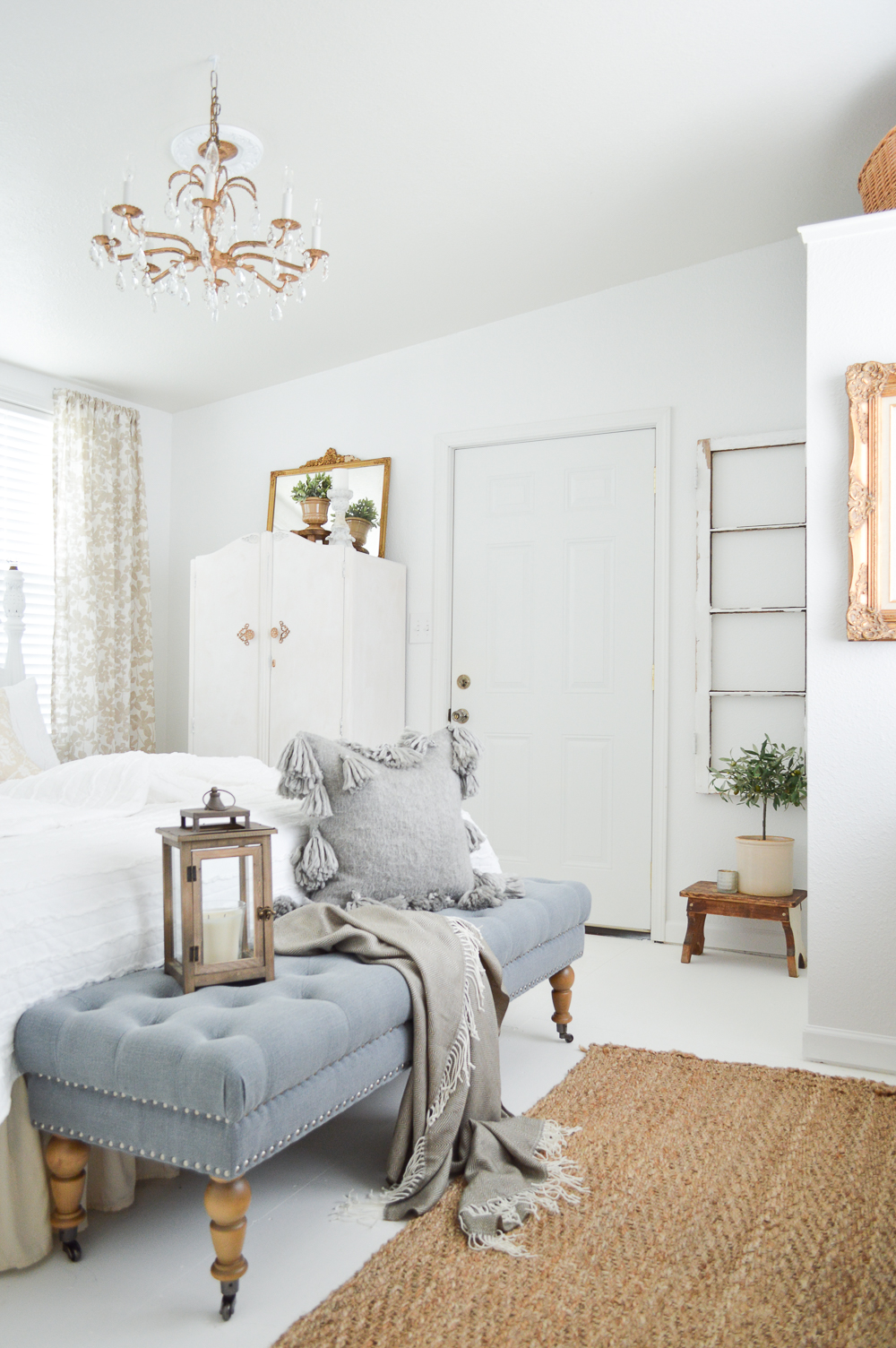 Vintage Cottage Guest Bedroom Makeover - Warm gold, white walls, tufted bench, cottage/farmhouse mix with french country accents.