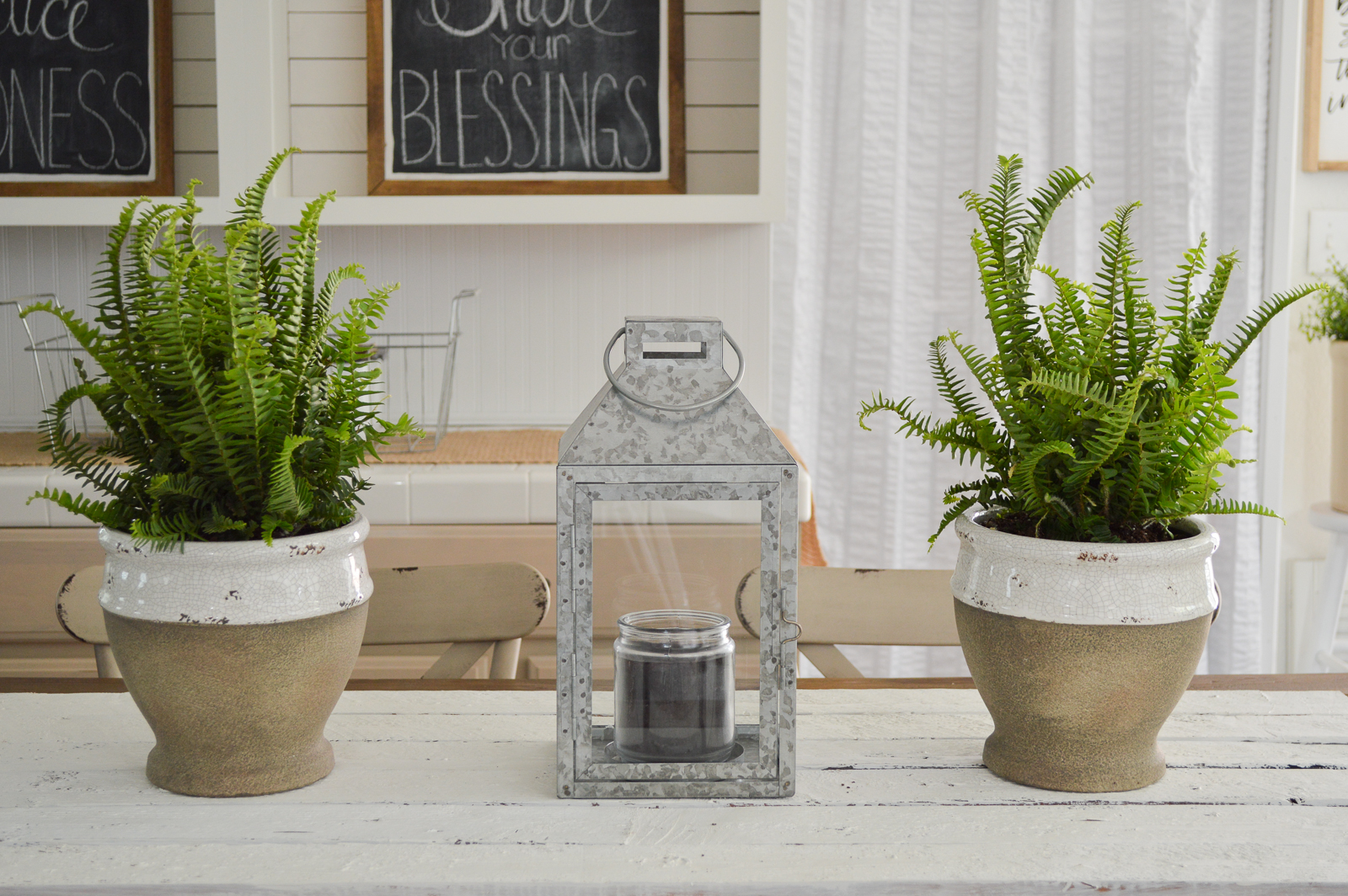 Outdoor In Spring Home Decor and Furniture Ideas #sponsored with Better Homes & Gardens at Walmart | concrete potted ferns, farm table, galvanized lantern