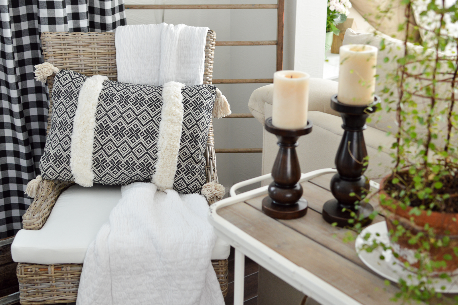 Outdoor In Spring Home Decor and Furniture Ideas #sponsored with Better Homes & Gardens at Walmart | Boho tassel pillow, woven chair, candle sticks, wood/metal farmhouse cart