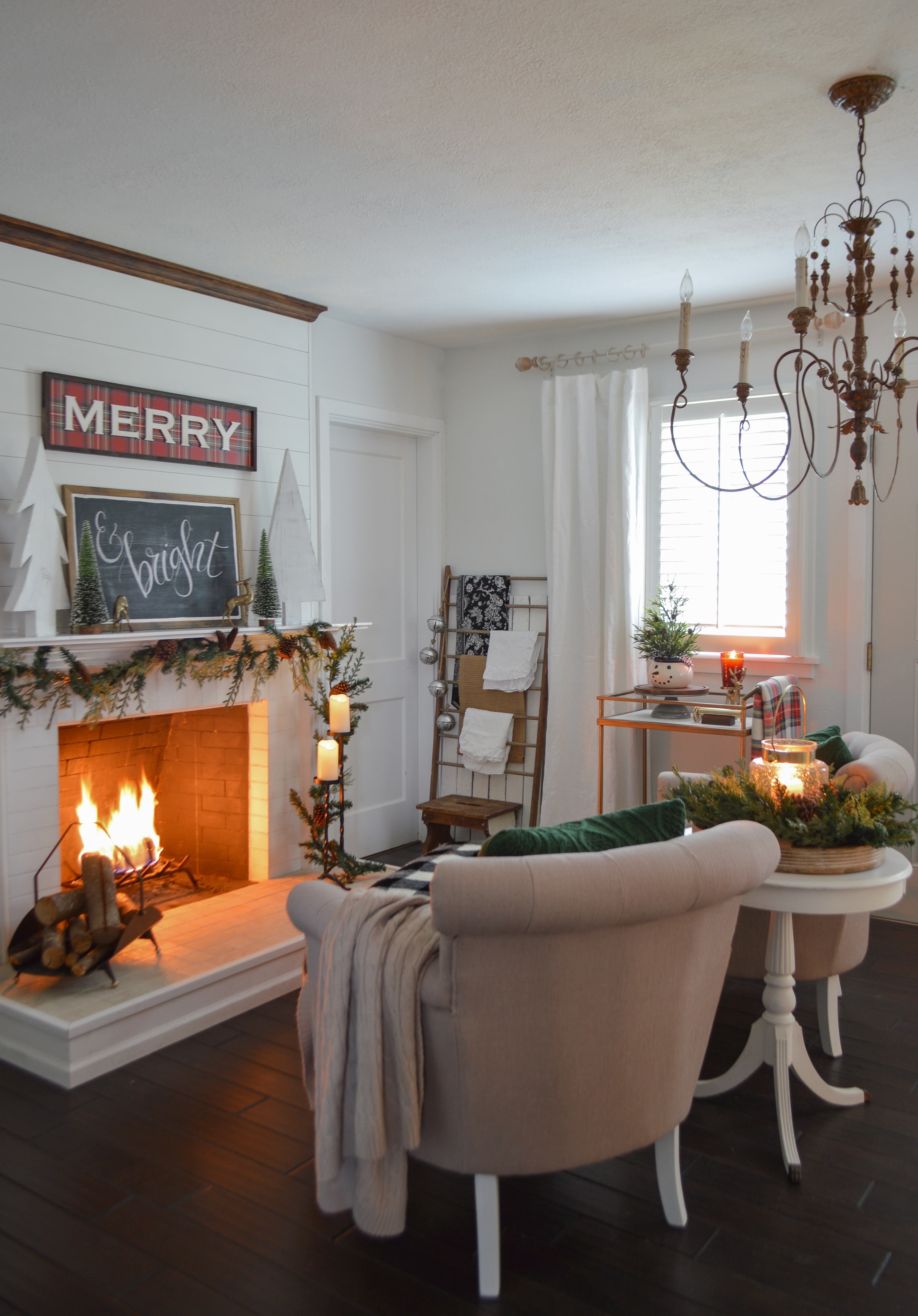 Holiday Housewalk Merry Christmas Home Tour - Cozy seating area, white shiplap fireplace, MERRY plaid and chalkboard signs, french country chandelier. #holidayhousewalk #christmashometour #cozychristmas #cottagechristmas #farmhousechristmas