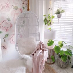 Pink floral wallpaper white swing chair bedroom